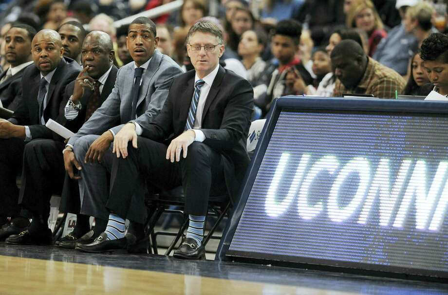UConn coach Kevin Ollie sits with his coaching staff during a recent game. Photo: The Associated Press File Photo   / AP2016