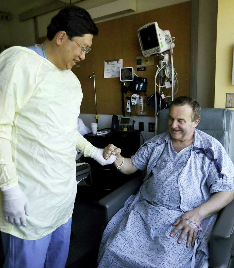 Thomas Manning, right, of Halifax, Mass. clasps hands with Dr. Dicken Ko, director of the urology program at Massachusetts General Hospital, Wednesday, May 18, 2016, in Boston. Manning is the first man in the United States to undergo a penis transplant. Dr. Ko co-led the surgical transplant team. Photo: AP Photo — Elise Amendola / Copyright 2016 The Associated Press. All rights reserved. This material may not be published, broadcast, rewritten or redistribu