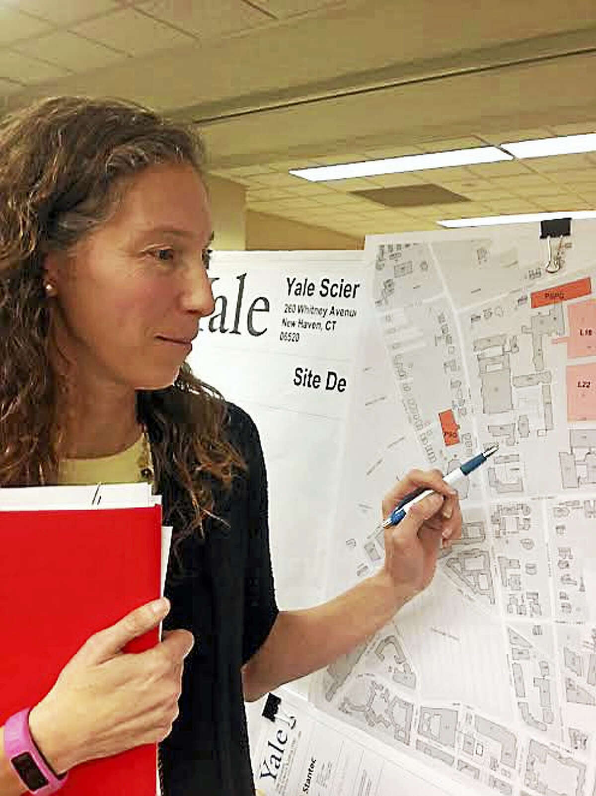 Lauren Zucker, a spokeswoman for Yale University, with a map of the planned new science building off Whitney Avenue.