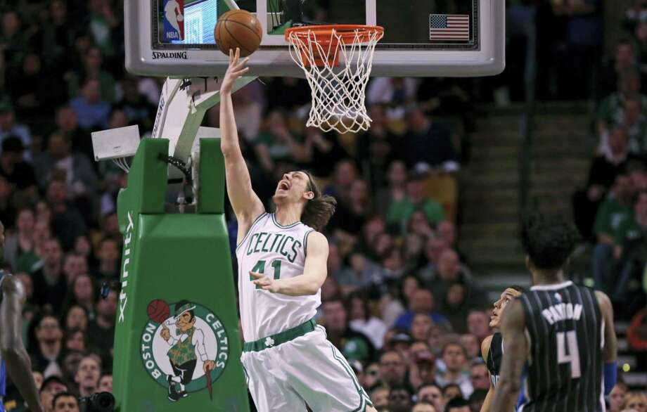 Boston Celtics center Kelly Olynyk (41) drops in a shot against the Orlando Magic during the second quarter Monday. Photo: The Associated Press   / Copyright 2016 The Associated Press. All rights reserved. This material may not be published, broadcast, rewritten or redistributed without permission.
