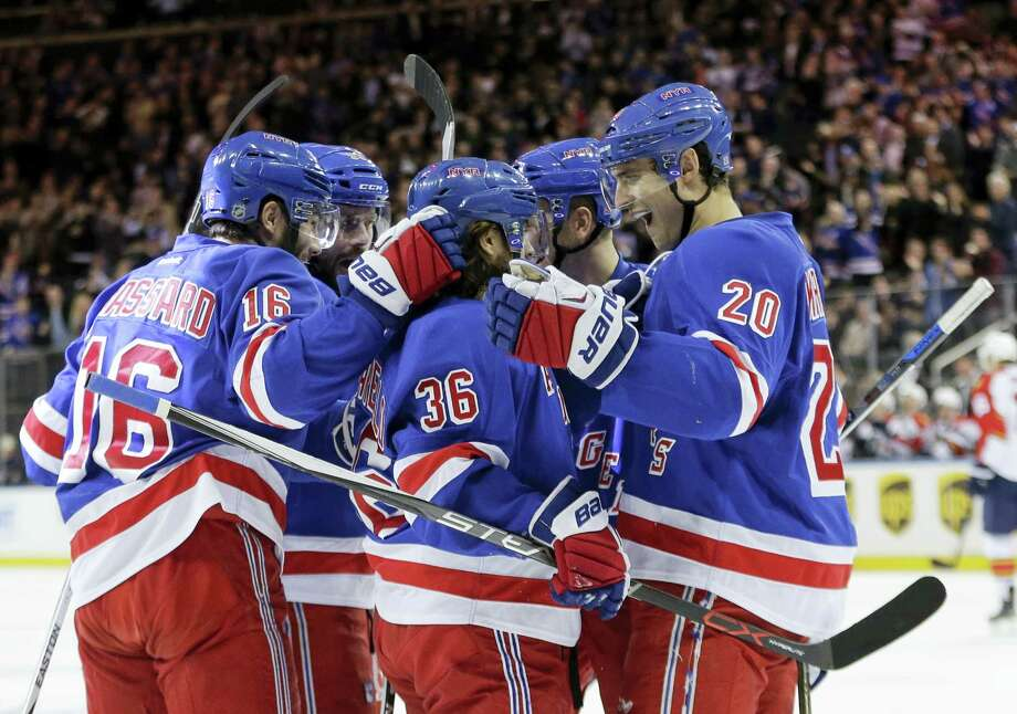 New York Rangers' Mats Zuccarello (36) celebrates with teammates Derick Brassard (16) and Henrik Lundqvist (30) after scoring a goal during the second period Monday. Photo: The Associated Press   / Copyright 2016 The Associated Press. All rights reserved. This material may not be published, broadcast, rewritten or redistributed without permission.