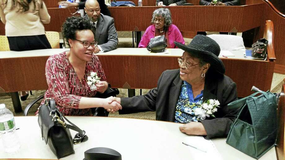 Stacy Lynch congratulates Lula White Thursday night at the Quinnipiac University School of Law Community Service Awards. White was the recipient of the Thurgood Marshall Award while Lynch received the Community Service Award. Photo: KATE RAMUNNI — NEW HAVEN REGISTER
