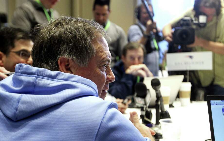 Patriots coach Bill Belichick, left, talks to a member of the media at the NFL owners meetings on Tuesday. Photo: Luis M. Alvarez — The Associated Press   / FR596 AP