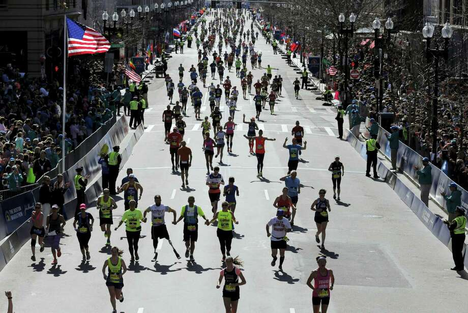 Runners approach the finish line of the 120th Boston Marathon on Monday, April 18, 2016, in Boston. (AP Photo/Charles Krupa) Photo: AP / AP