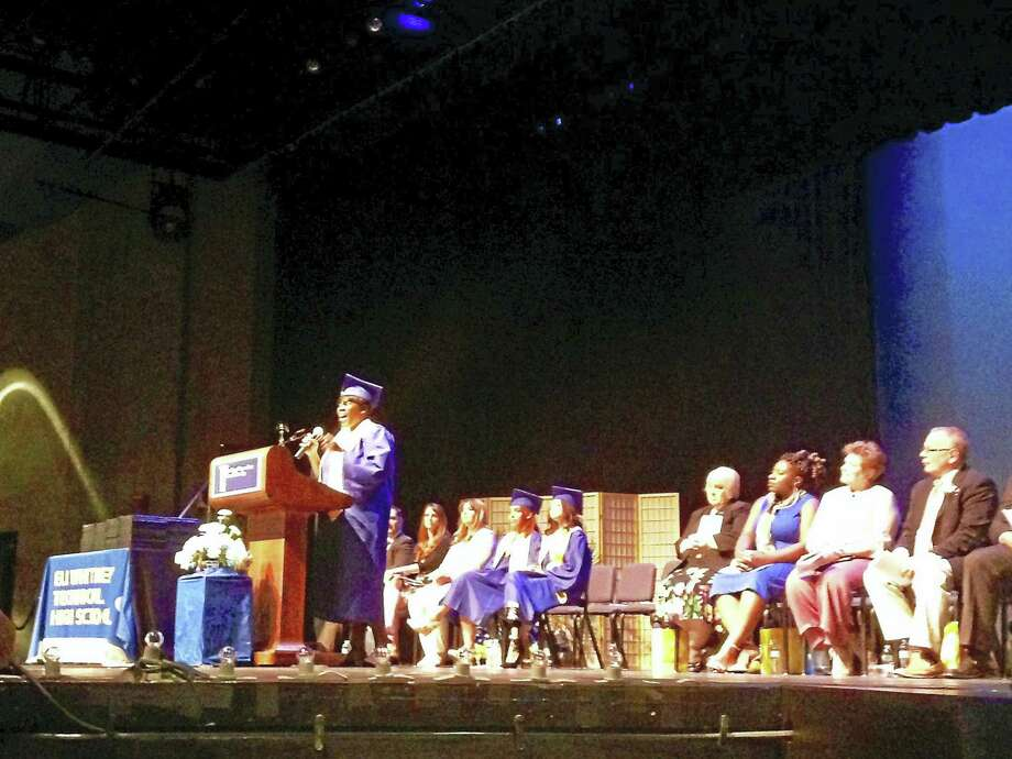 Domica Woodberry, Eli Whitney Technical High School senior class treasurer, sings a tibute song during graduation Tuesday night. Photo: Anna Bisaro — New Haven Register