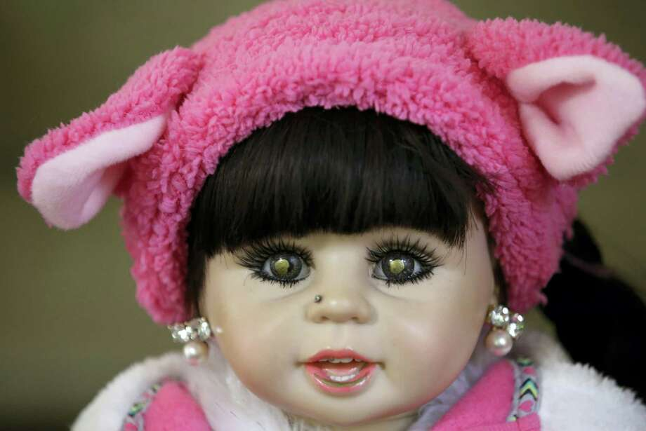 In this Thursday, Jan. 28, 2016 photo, a child angel doll sits on a chair in Bangkok. Thailand. The dolls, which are said to bring good luck to their owners, became a media sensation this week after a leaked memo from a Thai budget airline gave pointers on how they could be treated like passengers if they have a paid-for seat. Thai people are superstitious, and the doll phenomenon has been analyzed as a modern version of a traditional totem containing real body parts, but as a fad it seems have more in common with Furby dolls. (AP Photo/Sakchai Lalit) Photo: AP / AP