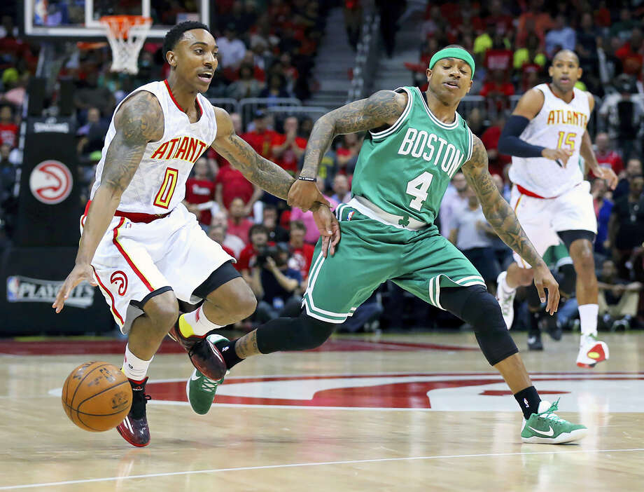 Hawks guard Jeff Teague drives against Celtics guard Isaiah Thomas during the first half on Tuesday. Photo: Curtis Compton — Atlanta Journal-Constitution Via AP   / Atlanta Journal-Constitution