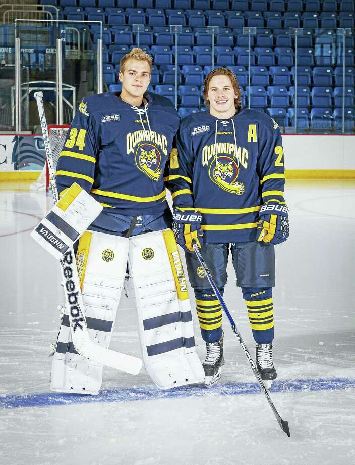 Prior to arriving at Quinnipiac, Michael Garteig, left,  and Travis St. Denis were teammates for the Penticton Vees, winning the Royal Bank Cup as Canada's Junior 'A' national champion. Photo: Photo Courtesy Quinnipiac Athletics   / © John Hassett 2015e