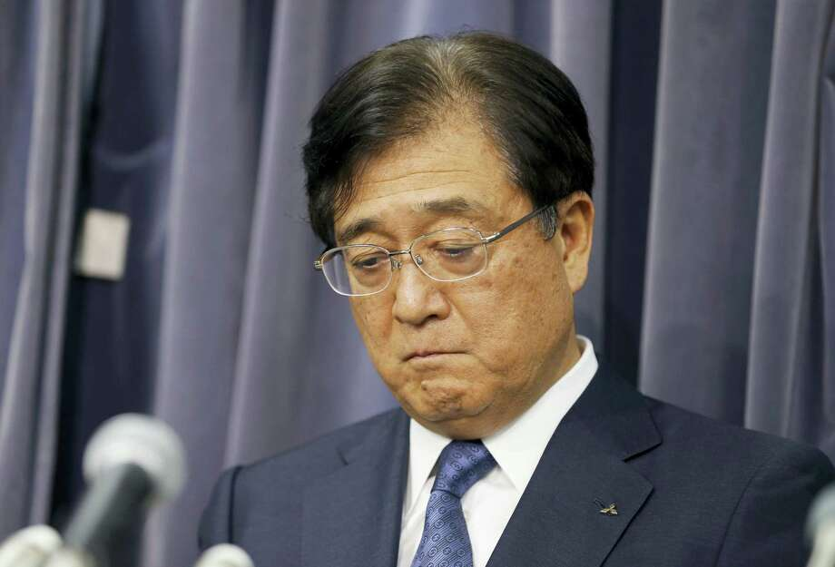 Mitsubishi Motors Corp. Chairman Osamu Masuko listens to a reporter's question during a press conference in Tokyo on May 18, 2016. Mitsubishi Motors President Testuro Aikawa said Wednesday that he will step down to take responsibility for the mileage cheating scandal unfolding at the Japanese automaker. Photo: AP Photo/Shizuo Kambayashi   / Copyright 2016 The Associated Press. All rights reserved. This material may not be published, broadcast, rewritten or redistribu