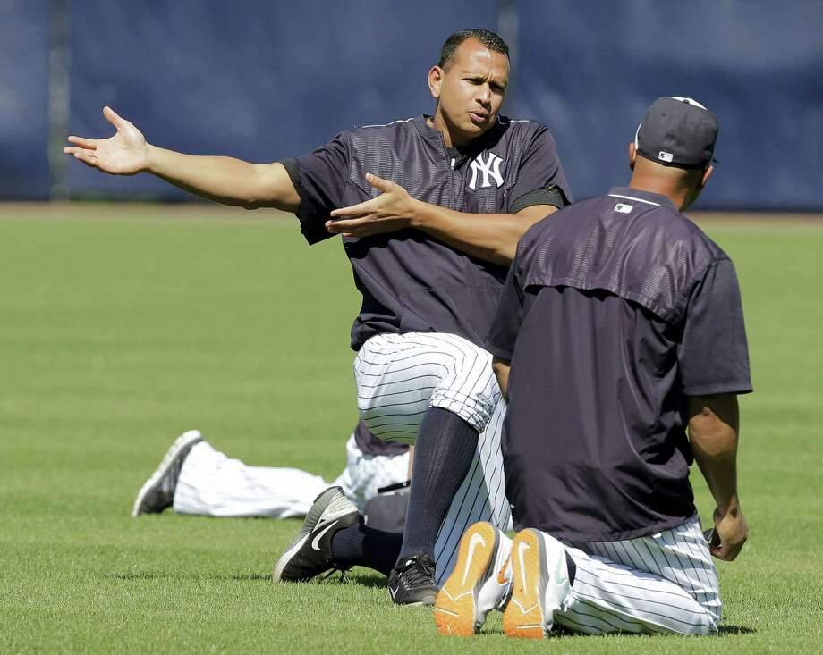 New York Yankees designated hitter Alex Rodriguez gestures as he stretches with Carlos Beltran before a spring training baseball game against the New York Mets Tuesday, March 22, 2016, in Tampa, Fla. (AP Photo/Chris O'Meara) Photo: AP / AP
