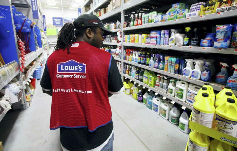 In this Nov. 14, 2011 photo, a Lowe's employee walks down an aisle in the store in Saugus, Mass. Photo: AP Photo/Michael Dwyer, File   / AP