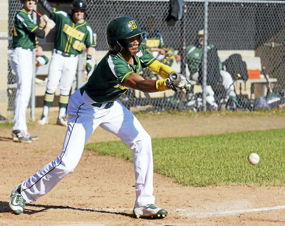 Hamden's Kwadir Delgado-McIntyre lays down a bunt Friday during the Green Dragons' victory over Hand. Photo: Dave Phillips — GameTime CT