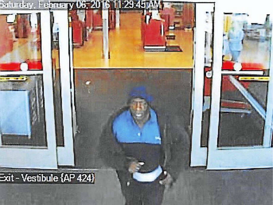 North Haven police are asking the public to help them identify this man, who allegedly stole a purse from a shopping cart Saturday at the Target store on Universal Drive North. Photo: Courtesy Of North Haven Police Department