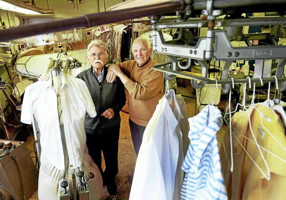 Brothers John Fabrizio, left, and Anthony Fabrizio, right, owners of Fab's Cleaners on Grand Avenue in New Haven, are closing their store after 71 years in business. Photo: PETER HVIZDAK — NEW HAVEN REGISTER   / ©2016 Peter Hvizdak