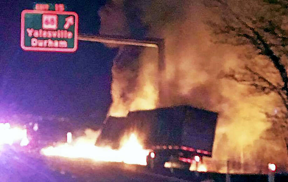 Wallingford firefighters responded to battle the flames after a tractor-trailer crashed, rolled over and caught fire early Tuesday on Interstate 91. Photo: Photo From Wallingford Fire Department IAFF Local 1326