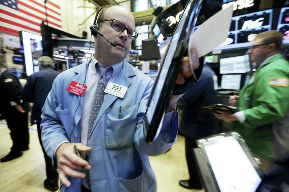 Trader Peter Mancuso makes his way across the floor of the New York Stock Exchange Wednesday. Photo: Richard Drew — The Associated Press   / Copyright 2016 The Associated Press. All rights reserved. This material may not be published, broadcast, rewritten or redistribu