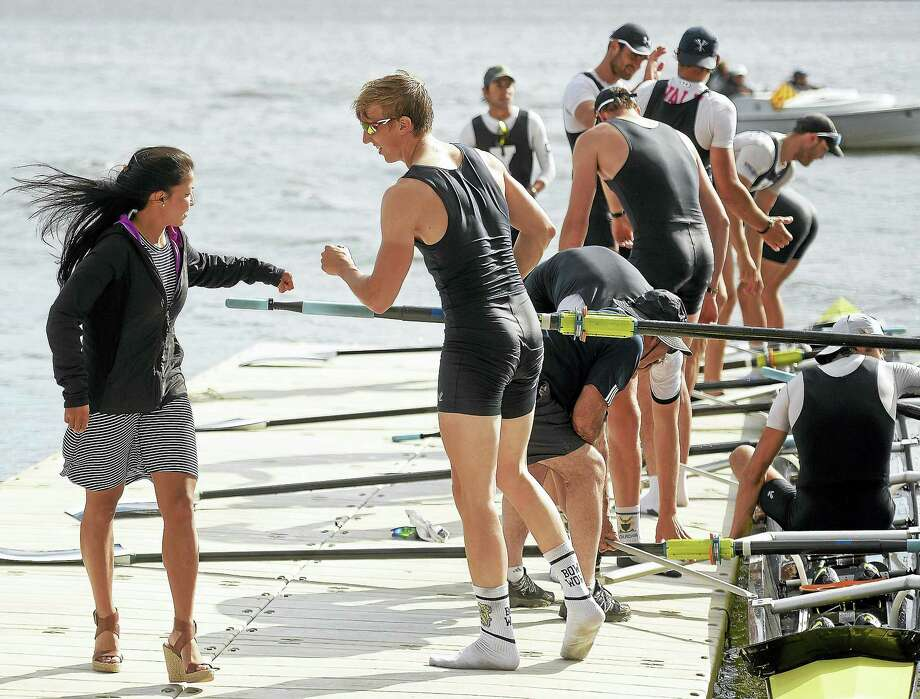 Yale third varsity coxswain Mackenzie Lee, left, exchanges a fist bump with first varsity bow seat rower Stephan Riemekasten on Sunday. Photo: Sean D. Elliot — The Day Via AP   / THE DAY