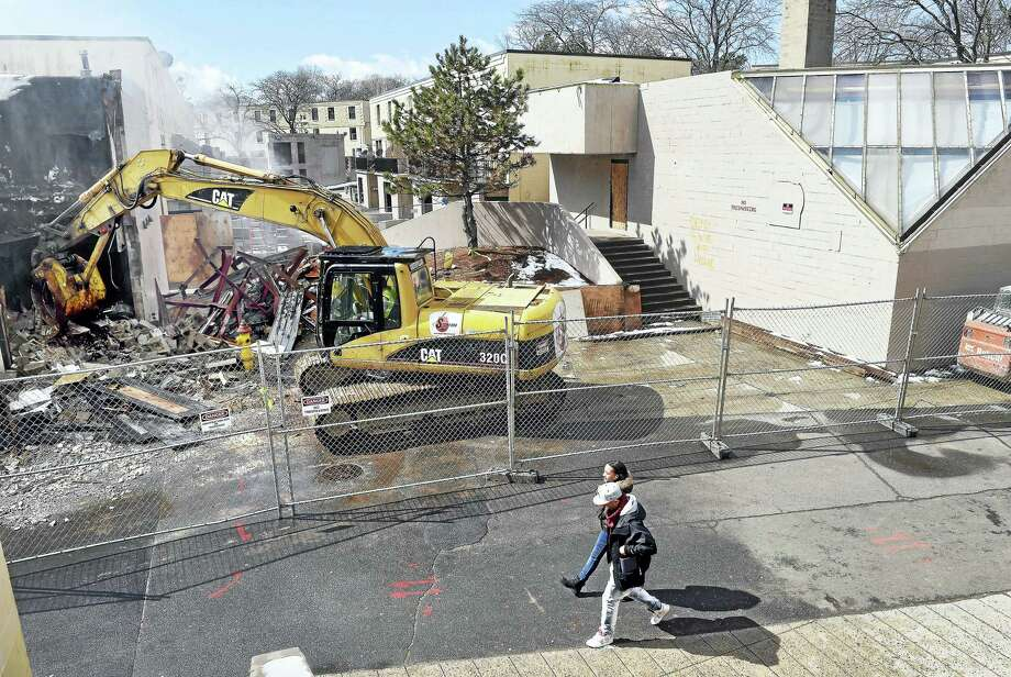 A former laundry building was demolished Monday at the Church Street South Apartments complex in New Haven. Demolition of a former day care center at right will follow. Photo: Arnold Gold — New Haven Register