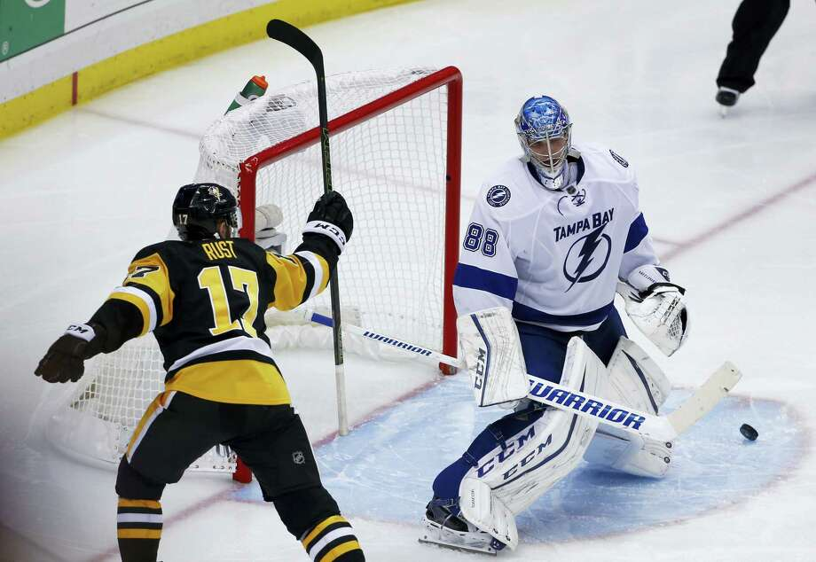 Pittsburgh Penguins' Bryan Rust (17) celebrates the winning goal by Sidney Crosby past Tampa Bay Lightning goalie Andrei Vasilevskiy during the overtime period of Game 2 of the NHL hockey Stanley Cup Eastern Conference finals, Monday, May 16, 2016, in Pittsburgh. The Penguins won 3-2. (AP Photo/Gene J. Puskar) Photo: AP / Copyright 2016 The Associated Press. All rights reserved. This material may not be published, broadcast, rewritten or redistribu