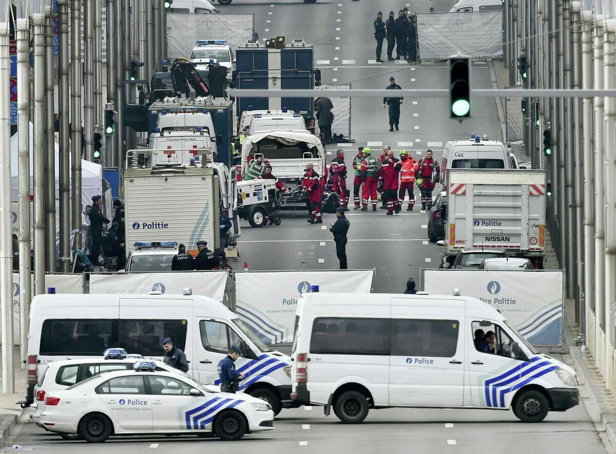 Police and rescue teams are pictured outside the metro station Maelbeek in Brussels, Tuesday, March 22, 2016. Explosions, at least one likely caused by a suicide bomber, rocked the Brussels airport and its subway system Tuesday, prompting a lockdown of the Belgian capital and heightened security across Europe.