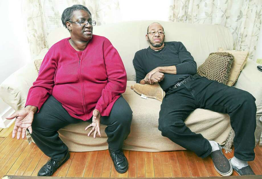 Lavenita Smith, left, and her husband , Frederick, talk in their home in New Haven recently about the unsolved shooting death of their son, Terrence Driffin-Smith.  Driffin-Smith died in the crossfire of a shooting on May 9, 2007. Photo: ARNOLD GOLD — NEW HAVEN REGISTER