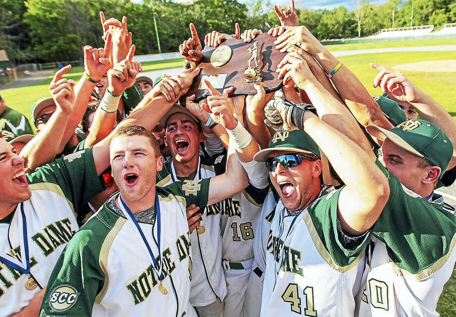 Notre Dame's baseball team celebrates after defeating East Lyme 5-2 in extra innings for the CIAC Class L title Sunday afternoon. Photo: Photo By John Vanacore For The Register   / John H.Vanacore/Register