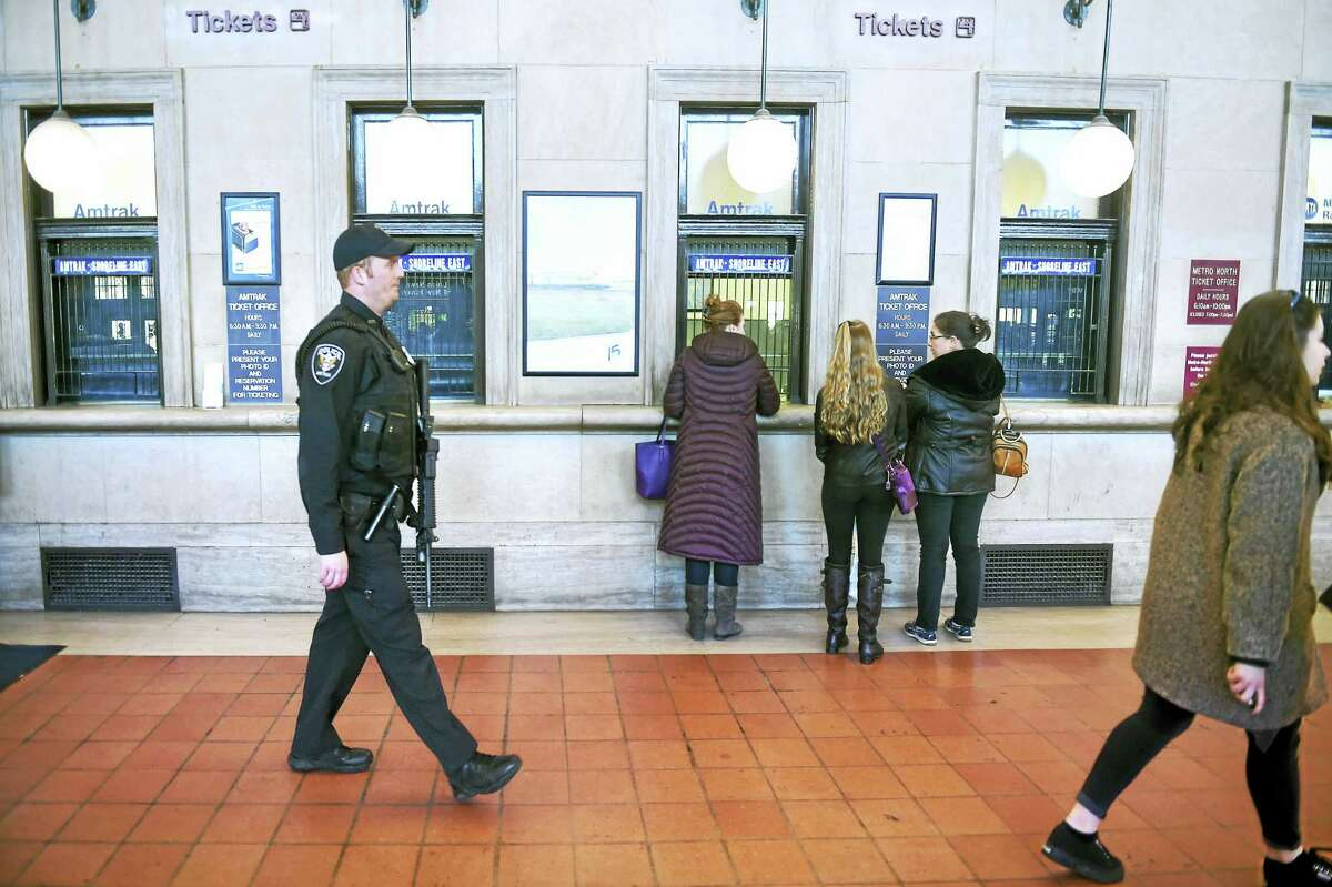 Amtrak Patrol Officer Kyle Befus, left, walks through Union Station in New Haven Tuesday.