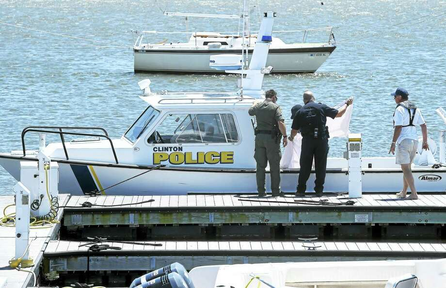 Clinton police recovered the body of a 44-year-old man from Long Island Sound and returned to the Clinton Town Docks Monday afternoon. Photo: Arnold Gold — New Haven Register