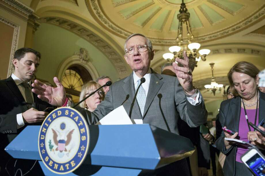 Senate Minority Leader Harry Reid of Nev., expresses his frustration with the Republican standoff with President Barack Obama over filling the Supreme Court vacancy created by the death of Justice Antonin Scalia, during a news conference on Capitol Hill in Washington, Tuesday, Feb. 23, 2016. Senate Majority Leader Mitch McConnell, R-Ky., had just announced that the Senate will take no action on anyone President Obama nominates to fill the vacancy, as nearly all Republicans rallied behind his calls to leave the seat vacant for the next president to fill. The announcement by McConnell came after Republicans on the Senate Judiciary Committee ruled out any hearing for an Obama pick. Photo: AP Photo/J. Scott Applewhite    / AP