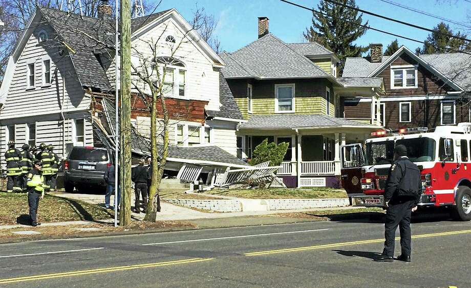 A house at 1548 Whitney Ave. in Hamden was severely damaged Tuesday morning after a SUV crashed into the front of it. Police say the SUV had been involved in an accident at Waite Street, then accelerated into the house. Photo: Wes Duplantier — New Haven Register