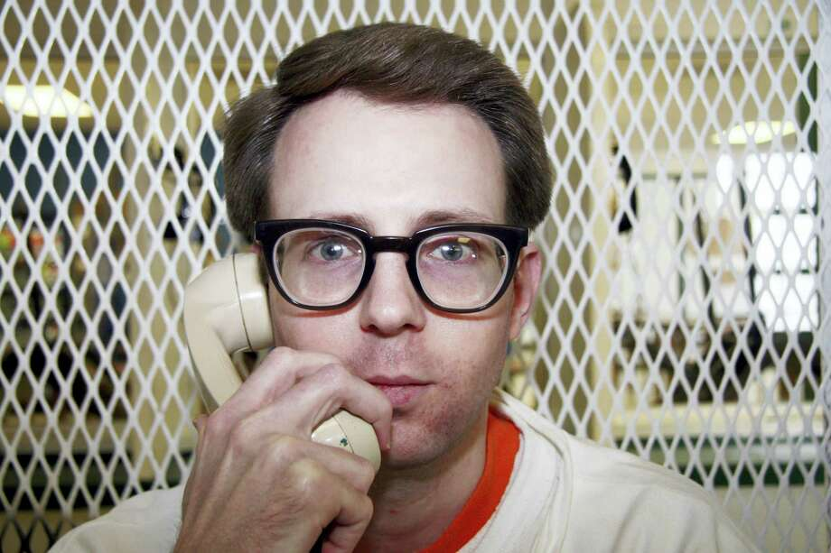 Convicted killer Adam Kelly Ward is photographed Feb. 10, 2016, in a visiting cage outside death row at the Texas Department of Criminal Justice Polunsky Unit near Livingston, Texas. Ward, 33, is set for lethal injection March 22, 2016, for fatally shooting code enforcement officer Michael Walker in Commerce, Texas, in 2005 in a trash dispute. Walker was taking pictures of Ward's home, where court documents say rubbish was hoarded inside and outside. Photo: AP Photo/Michael Graczyk    / AP