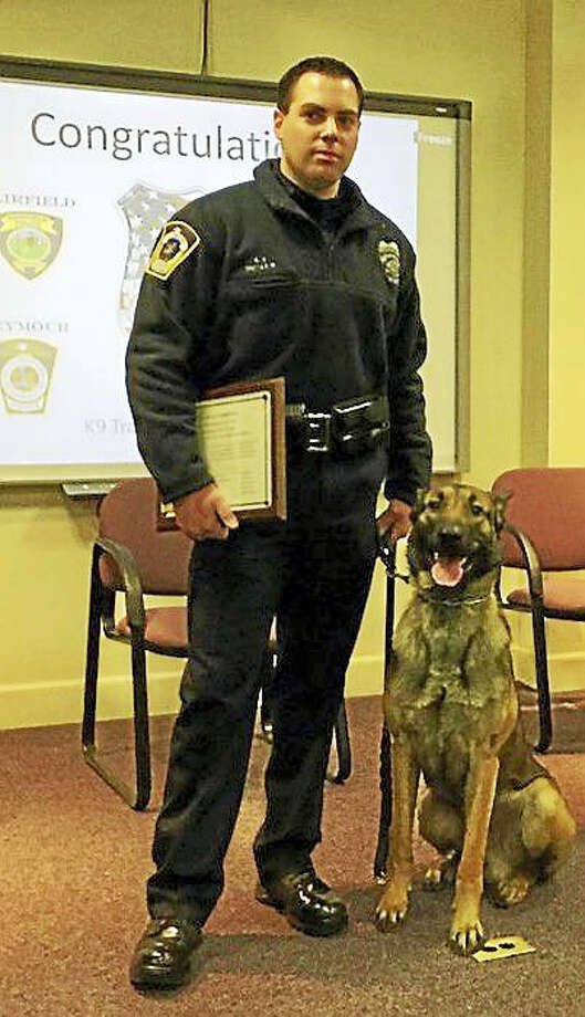 Officer Matthew Butler and Rex. Photo: CONTRIBUTED PHOTO — SEYMOUR POLICE DEPARTMENT