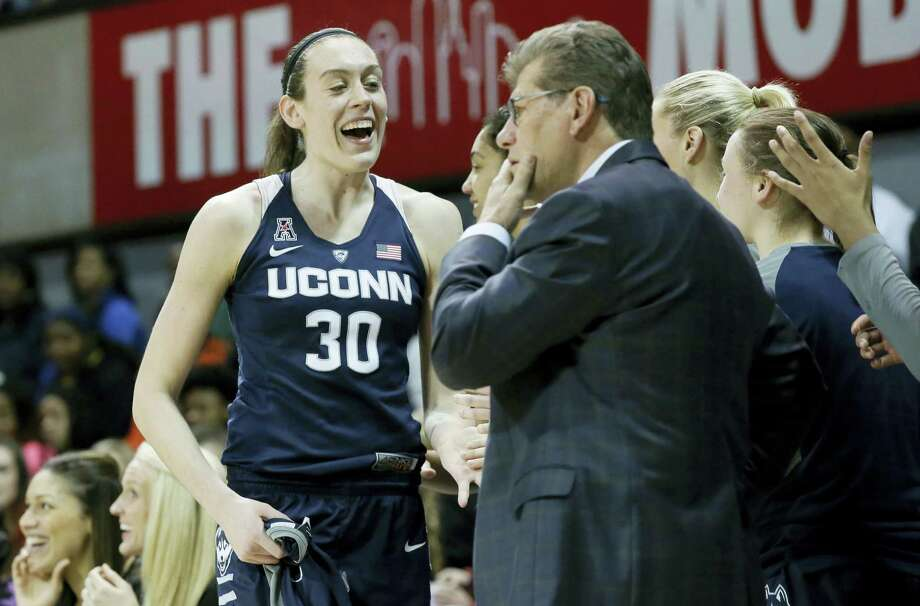 Connecticut forward Breanna Stewart (30) is congratulated by teammates as she comes out of the game during the second half of an NCAA college basketball game against SMU Saturday, Jan. 23, 2016, in Dallas. UConn won 90-37. (AP Photo/LM Otero) Photo: AP / AP
