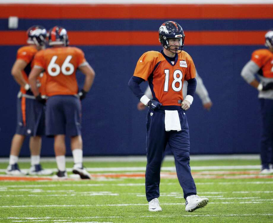Broncos quarterback Peyton Manning waits to throw during practice Friday in Englewood, Colo. Photo: David Zalubowski — The Associated Press   / AP