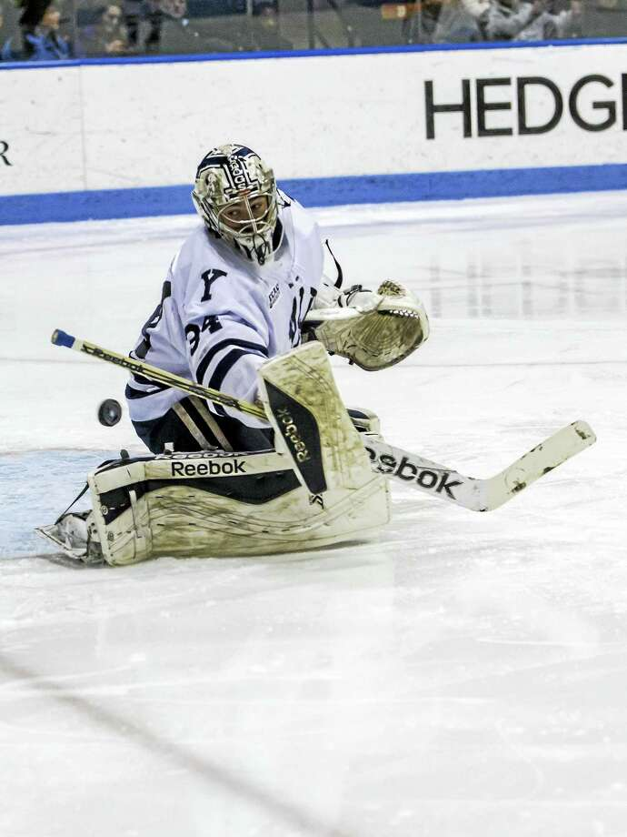 Yale goalie Alex Lyon tries to make a save during Friday's game. Photo: Photo By Steve Musco   / ©2016 Steve Musco. All rights reserved.