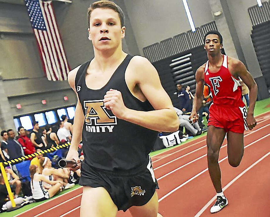 Amity's Kyle Beaudette runs the fourth leg of the 4 x 800 meter relay at the SCC Indoor Eastern Sectional Meet Thursday at the Floyd Little Athletic Complex in New Haven. Photo: Catherine Avalone -- New Haven Register