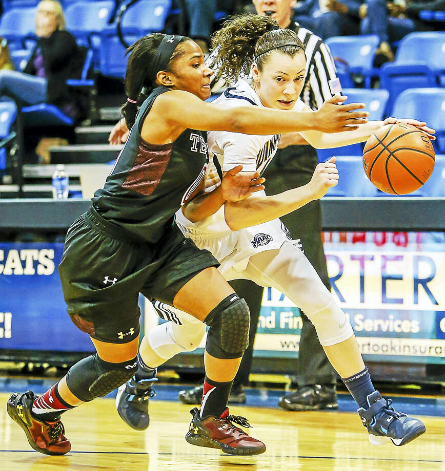 Qunnipiac's Adily Martucci drives to the hoop against Temple's Aliya Butts during the Bobcat's 64-62 loss to the Owls in the 2nd round of the WNIT Tournament Sunday.-John Vanacore/Register Photo: Journal Register Co. / John Vanacore/Register