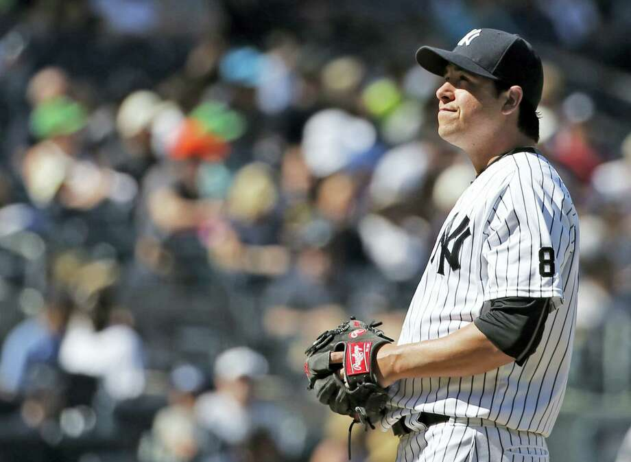 Yankees relief pitcher Anthony Swarzak reacts after allowing a two-run home run to Ian Kinsler in the seventh inning on Sunday. Photo: Kathy Willens — The Associated Press   / Copyright 2016 The Associated Press. All rights reserved. This material may not be published, broadcast, rewritten or redistribu