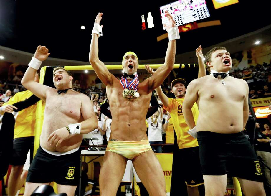 """Olympic swimmer and most decorated olympian of all-time, Michael Phelps, center, performs behind the """"Curtain of Distraction"""" during an Oregon State free throw against Arizona State during the second half of an NCAA college basketball game, Thursday, Jan. 28, 2016, in Tempe, Ariz. Photo: AP Photo/Matt York    / AP"""