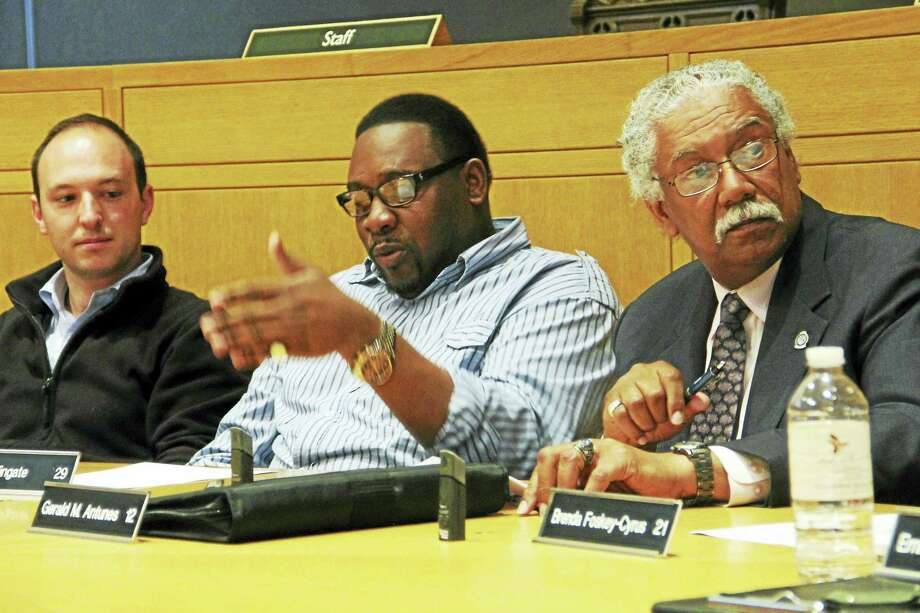 New Haven Alder Brian Wingate, D-29, center, talks while seated next to Alders Aaron Greenberg, D-8, left, and Gerald M. Antunes, D-12, during a Public Safety Committee meeting Tuesday at City Hall. Photo: Esteban L. Henandez — New Haven Register