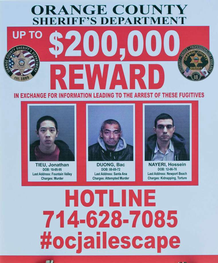 A wanted sign is displayed showing the reward for information leading to the arrest of the three escaped inmates from the Orange County Central Men's Jail on Tuesday, Jan. 26, 2016, in Santa Ana, Calif.  Hossein Nayeri, Jonathan Tieu and Bac Duong are believed to be dangerous and all were awaiting trial for separate violent felonies, authorities said. Photo: Paul Rodriguez/The Orange County Register Via AP    / The Orange County Register