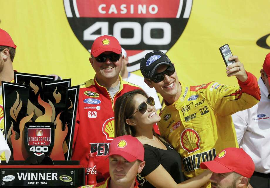 Joey Logano takes a selfie with his wife Brittany Baca after winning at Michigan International Speedway on Sunday. Photo: Carlos Osorio — The Associated Press   / AP