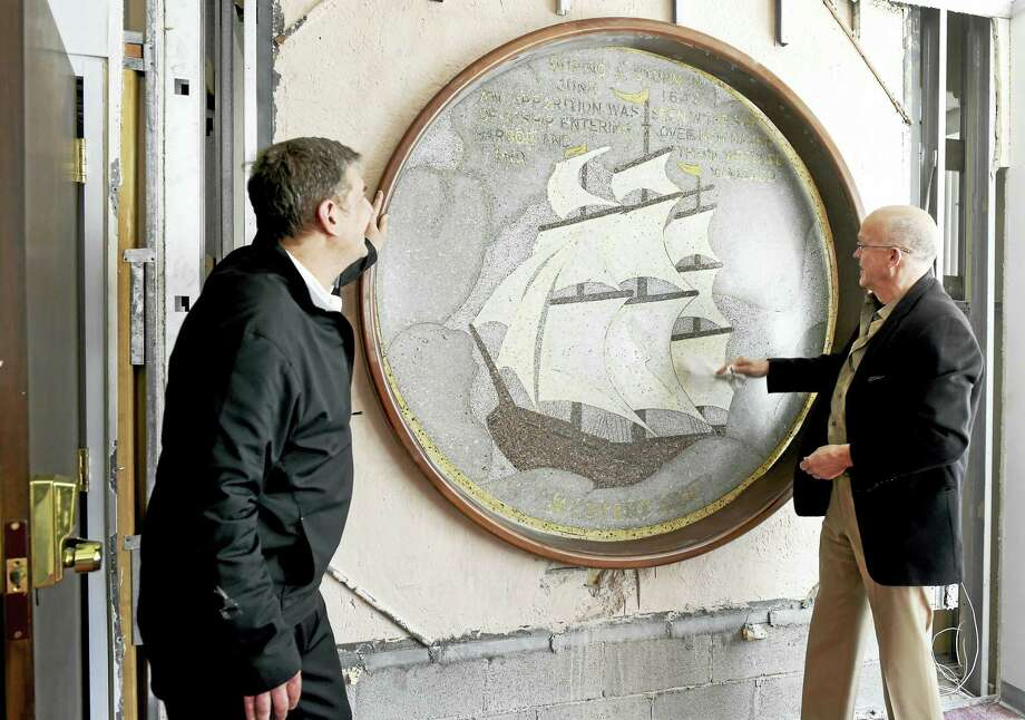Alex Marathas, project manager of Northside Development of New Haven, left, and Architect Richard Wies of Gregg, Wies and Gardner Architects LLC of New Haven with a terrazzo panel of the Ghost Ship of New Haven in the Exchange Building at 123-127 Church St. in New Haven. Photo: Peter Hvizdak — New Haven Register   / ©2016 Peter Hvizdak