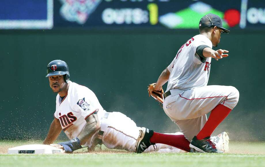 Byron Buxton, left, safely steals second base as Red Sox shortstop Xander Bogaerts applies the late tag on Sunday. Photo: Ann Heisenfelt — The Associated Press   / FR13069 AP