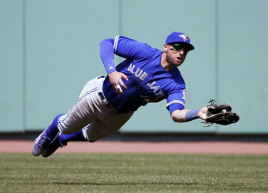 Toronto Blue Jays center fielder Kevin Pillar makes a diving catch on a fly ball by Boston Red Sox's Jackie Bradley Jr. during the eighth inning of the Blue Jays' 4-3 win over the Red Sox Monday afternoon. Photo: MARY SCHWALM - THE ASSOCIATED PRESS   / FR158029 AP