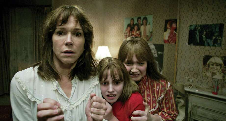 "This image released by Warner Bros. shows, from left, Frances O'Connor, Madison Wolfe and Lauren Esposito in a scene from the New Line Cinema thriller, ""The Conjuring 2."" Photo: Warner Bros. Via AP   / Warner Bros."