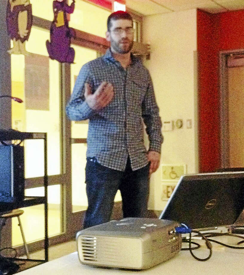 Tim Wilson pitches a proposed craft beer brewery in New Haven's East Rock neighborhood at a management team meeting Monday night. Photo: Mary O'Leary — New Haven Register