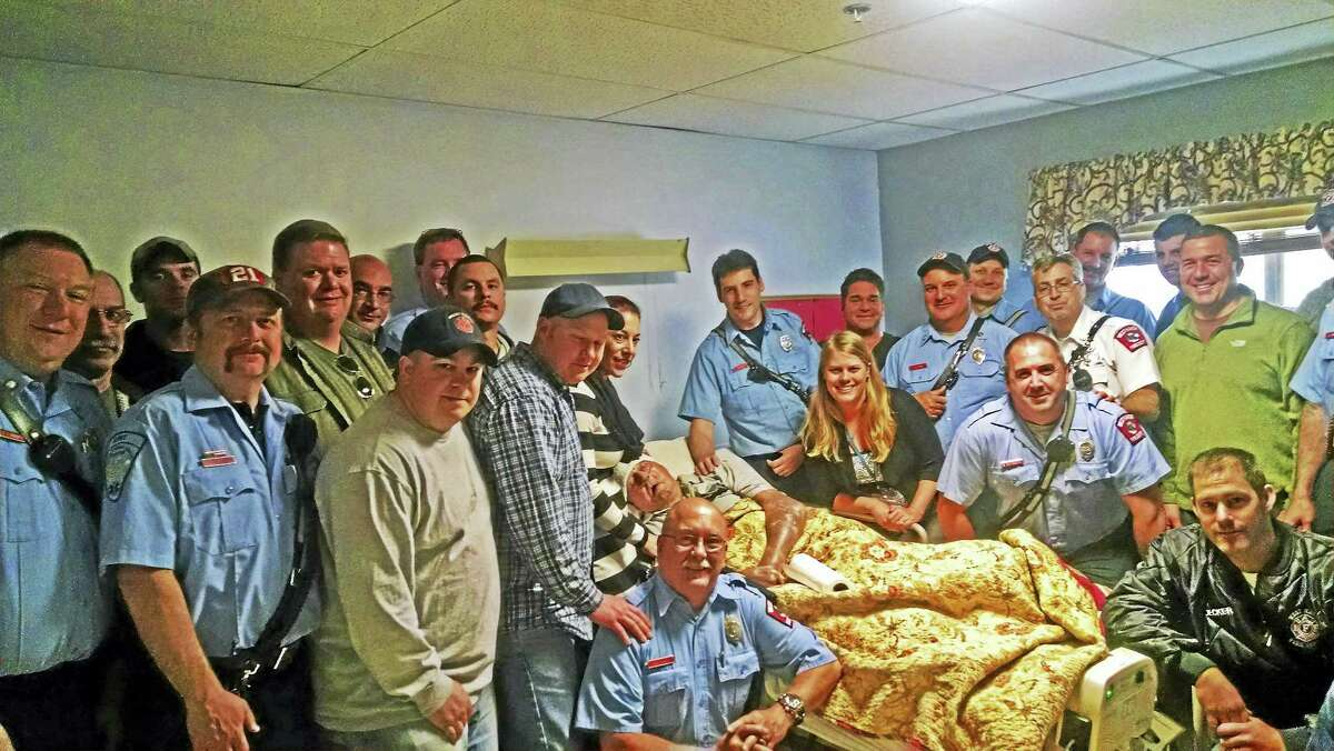 Contributed photo Members of the West Haven Fire Department at the beside of Gordon Barrett, a former West Haven firefighter. Barrett was the last living charter member of the firefighters union Local 1198.