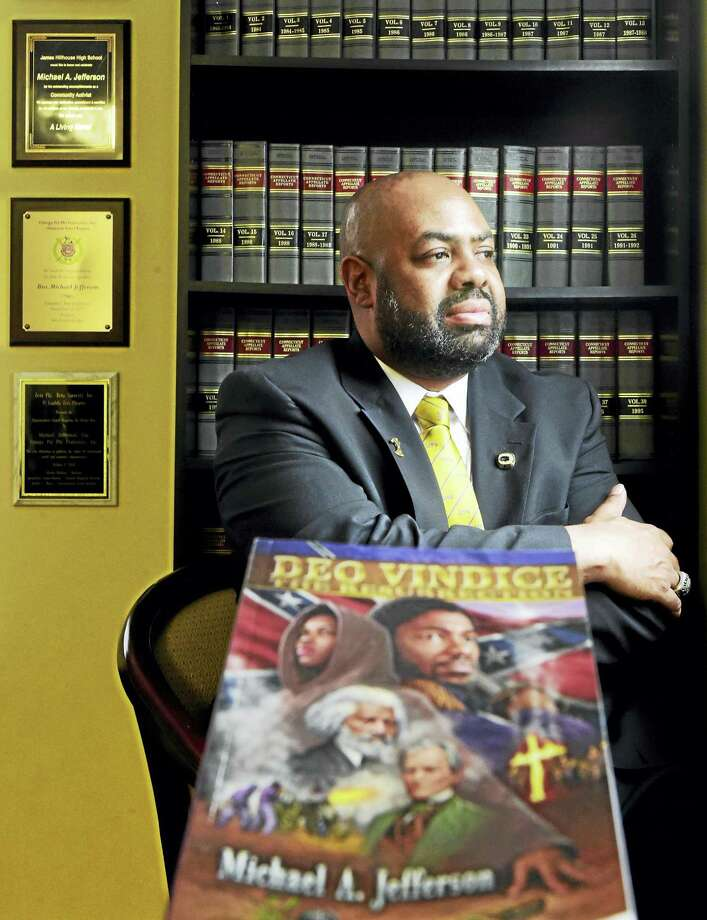 "(Peter Hvizdak - New Haven Register) ¬ Attorney Michael Jefferson, author of ""Deo Vindice, The Resurrection"" in his East Haven office Thursday, March 10, 2016.  The book is about one mans's obsession for justice in the face of excruciating racial injustice by empowering its victims to take matters into their own hands. Photo: ©2016 Peter Hvizdak / ©2016 Peter Hvizdak"