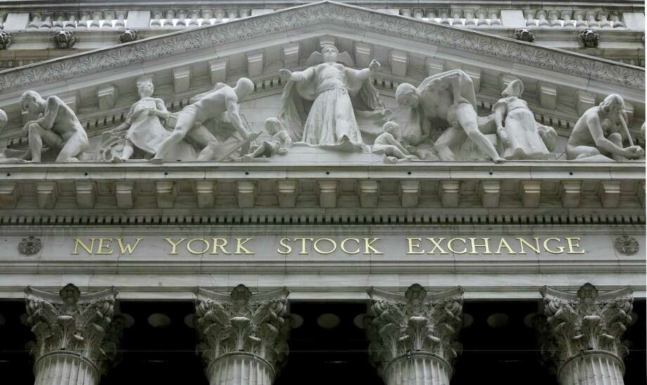 FILE - This Oct. 4, 2014, file photo, shows the facade of the New York Stock Exchange. Stocks are off to a mixed start Monday, March 21, 2016, as the market comes off its fifth straight week of gains. Photo: THE ASSOCIATED PRESS / AP